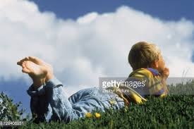 children looking up at clouds