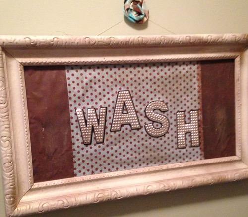 wash sign in bathroom